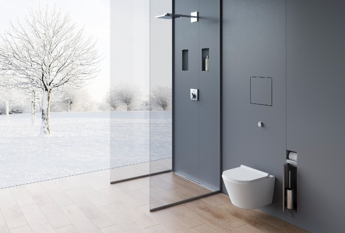 A modern bathroom with wall niches to stow shampoos, shower gels and other bathroom items